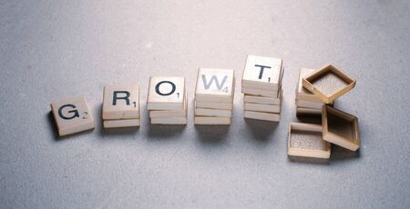 Growth tag label composed in  letters