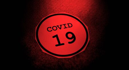 Close up of a COVID-19 text tag on paper