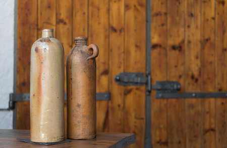 Vintage vintage vases in front of a rustic background Stock Photo