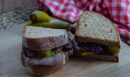 Rustical roast beef sandwich with cucumbers