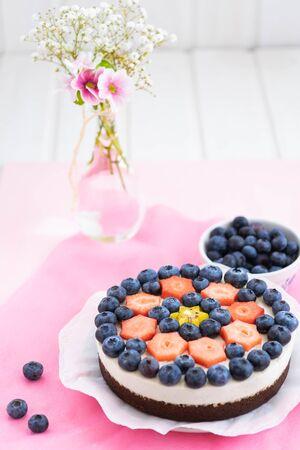 Vegan cheesecake with chocolate flan case and vegan cream cheese, ground almonds, vanilla pulp and fresh fruits Stok Fotoğraf
