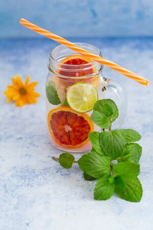 Fresh detox infused aroma water in glass with orange, lime and mint for healthy weight loss Reklamní fotografie