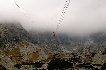 Cableway to Lomnica peak in fog, High Tatras Mountains, Slovakia
