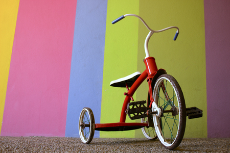 tricycle: Red Kids Bike with Colorful Background