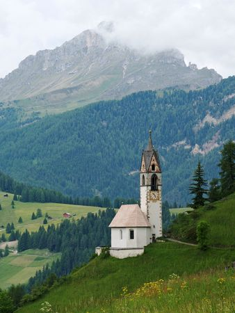 little chapel in the dolomites, italy photo