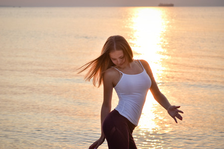 Girl dancing at the beach