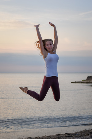 Girl jumping for joy at the beach