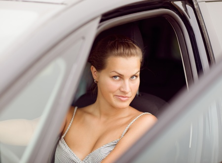 Beautiful Girl Portrait with Her New Vehicle photo