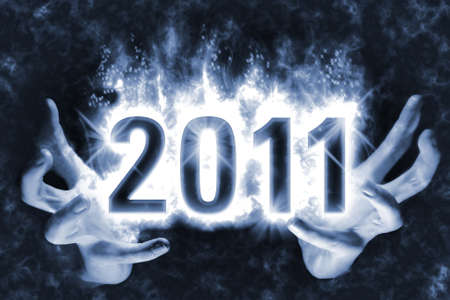 celebartion: Happy New Year background with effect of cast magic spell, blue energy flames wrapping around digits 2011 in the dark glowing between hands