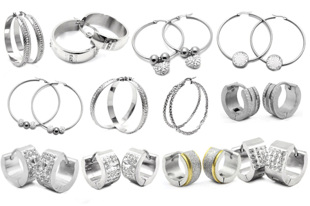 silver jewelry: Earring. Womens jewelry. White background. Silver and stainless steel.