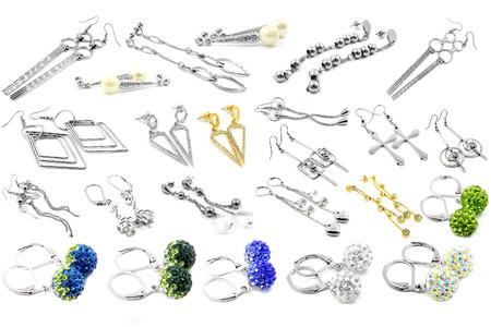 Earrings for women. Set. Stainless steel. White background. Stock Photo