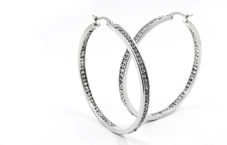 Luxury earrings for women. Silver on a white background