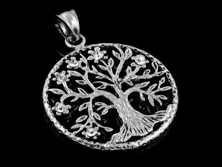 Necklace, Pendant for Women - Symbol Tree of Life - Stainless Steel - One color background Stock Photo