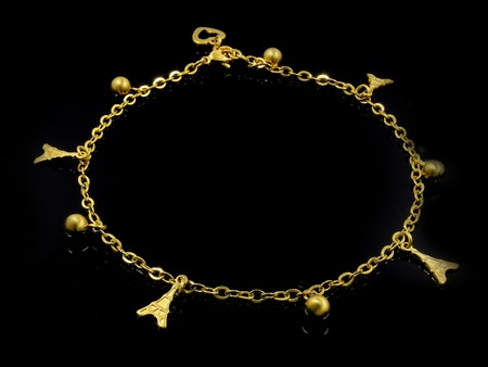 Ankle bracelet with pendants. Stainless steel. One background color