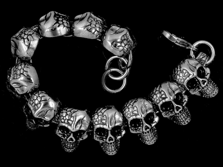 Jewelry bracelet for men. Skulls, crosses and classic. Stainless steel. One color background