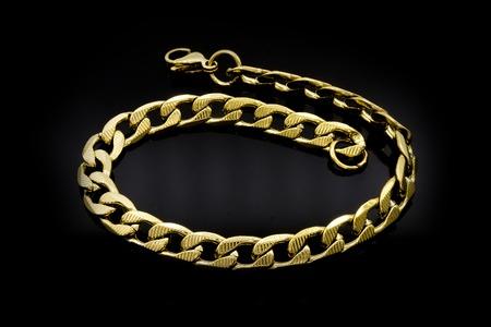 Złota bransoletka z klejnotami. Stal nierdzewna. Jeden kolor tła