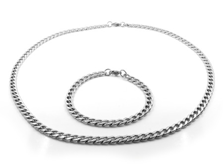 Jewelery set. Necklace and bracelet. Stainless steel. One color background