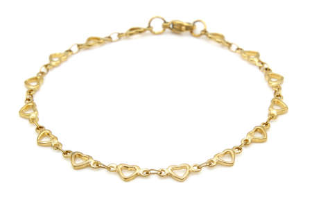 Jewelry bracelet. Gold finish. Stainless steel. White color background