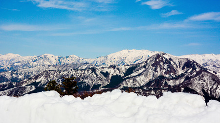 Snow capped mountains with blue sky in sunny day.Yuzawa,Niigata,Japan