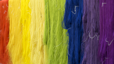 Colorful Cotton threads in textile fabric.background and wallpaper.silk production in thailand.