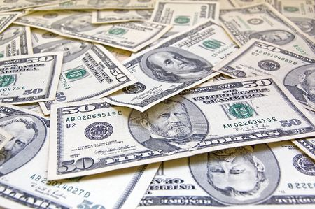 Pile of banknotes of fifty and hundred dollars photo