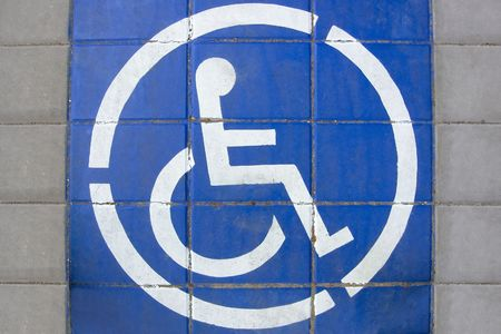 Disabled People Sign drawn on the ground of street photo