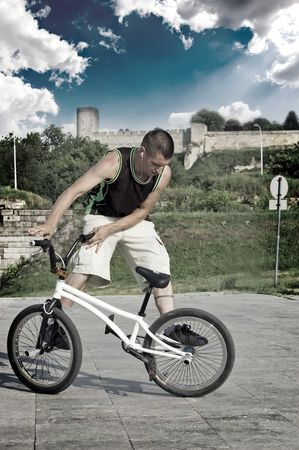Extreme bicycle rider performing freestyle tricks on his bike. photo