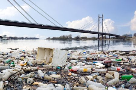 pollution: Photograph of polluted River full of rubbish showing environment we live in.