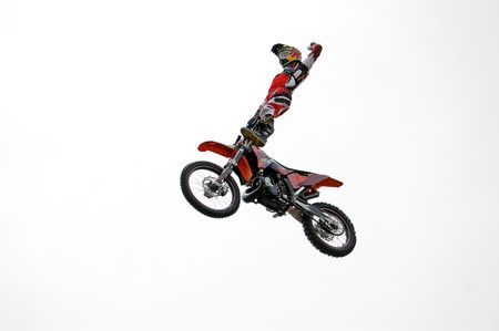 Motocross rider performing dangerous jumps with his bike. photo