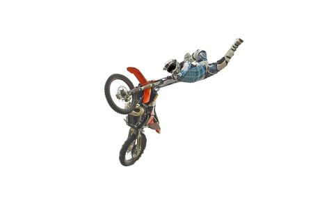 freestyle: Motocross rider performing dangerous jumps with his bike isolated on white.
