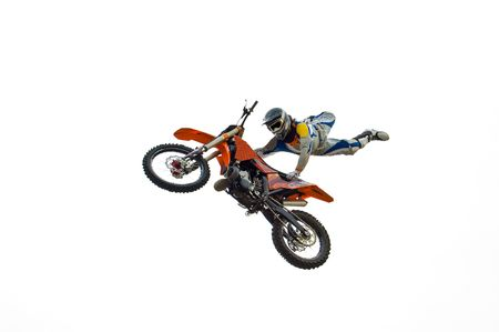 freestyle: Extreme motocross biker performing dangerous trick with his bike Stock Photo