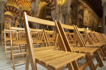 Strategically placed chairs inside the famous Mosque. Cordova. Andalusia. Spain.