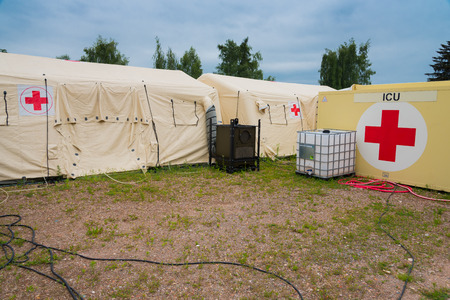 A field hospital is a small mobile medical unit, or mini hospital, that temporarily takes care of casualties on-site before they can be safely transported to more permanent hospital facilities. This term is used overwhelmingly with reference to military s