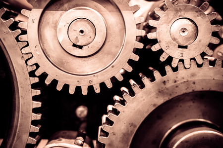 industrial equipment: Big greasy gears in the old machine. Stock Photo
