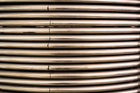 shiny metal background: Texture long shiny metal pipes closeup, background. Stock Photo