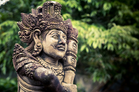 Stone carved balinese statue