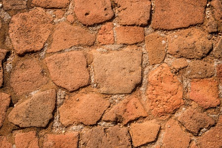 Old cobblestone road with soil between stones. Texture and background.