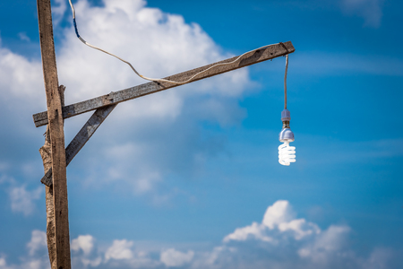 Electric lamp on wooden pole. Homemade lamp.