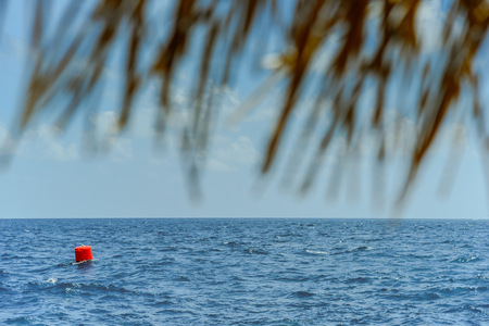 Red buoy Navigation or lateral Marks floating in the sea Banco de Imagens