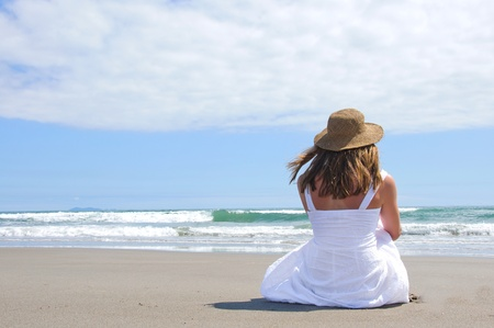 sunhat: Sitting at the beach with sunhat on