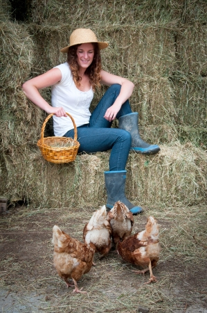 gumboots: Farm girl with chickens Stock Photo