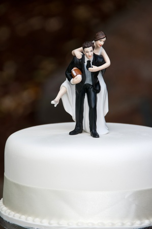 Bride and Groom on wedding cake photo