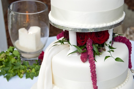 Wedding cake and remembrance candle Stock Photo
