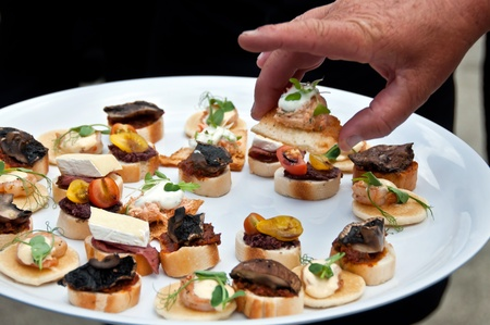 person appetizer: Selection of canapes Stock Photo