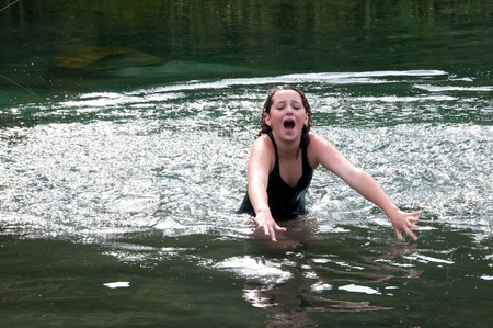 Girl scared of something in the river