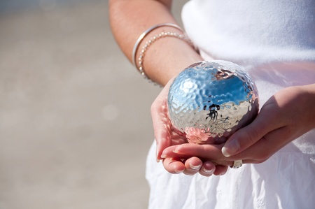 Hands holding a silver ball Stock Photo