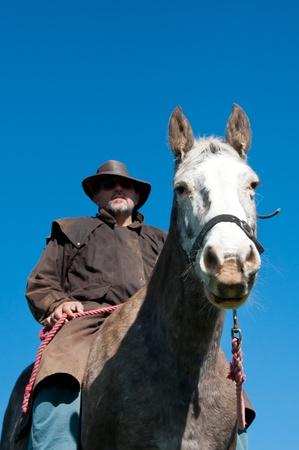 stockman: Farmer and horse