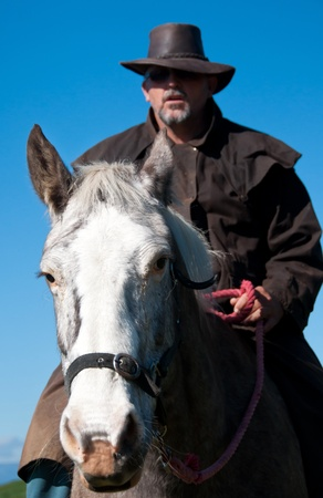 Farmer on horse Stock Photo