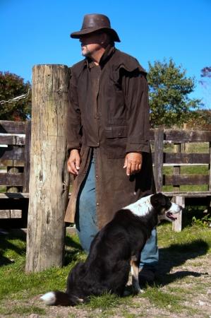 stockman: Farmer and farm dog Stock Photo