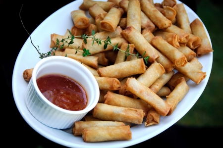 spring rolls with chilli sauce dip Stock Photo